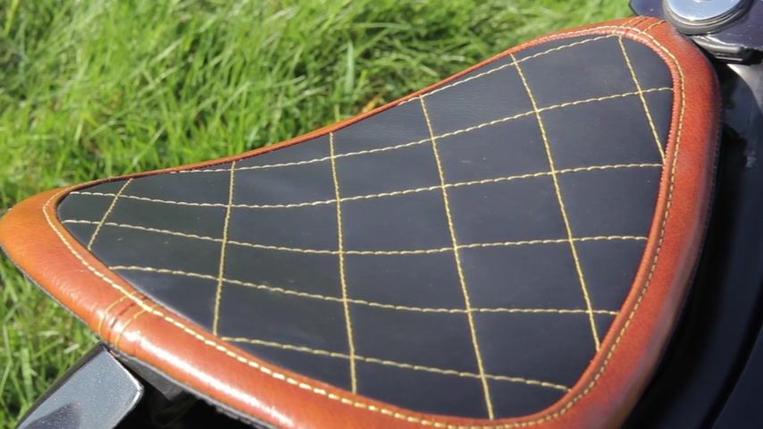 spona : leather saddle motobike close-up