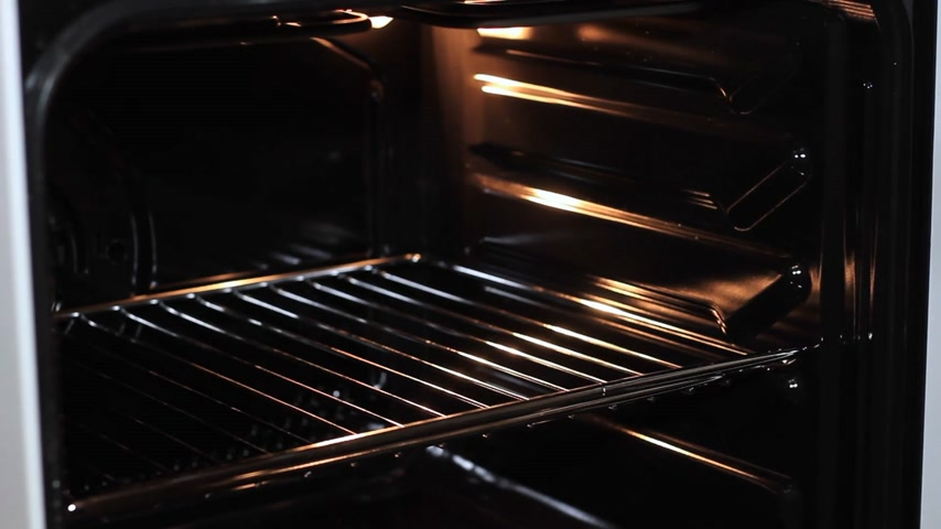 fondán : The girls hands make pastry pies in the oven close-up