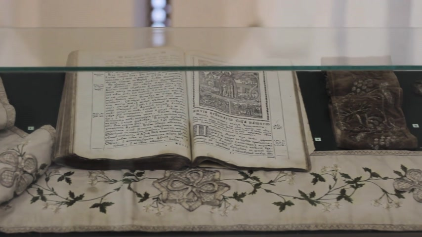 świecznik : ancient bible on the table in the church