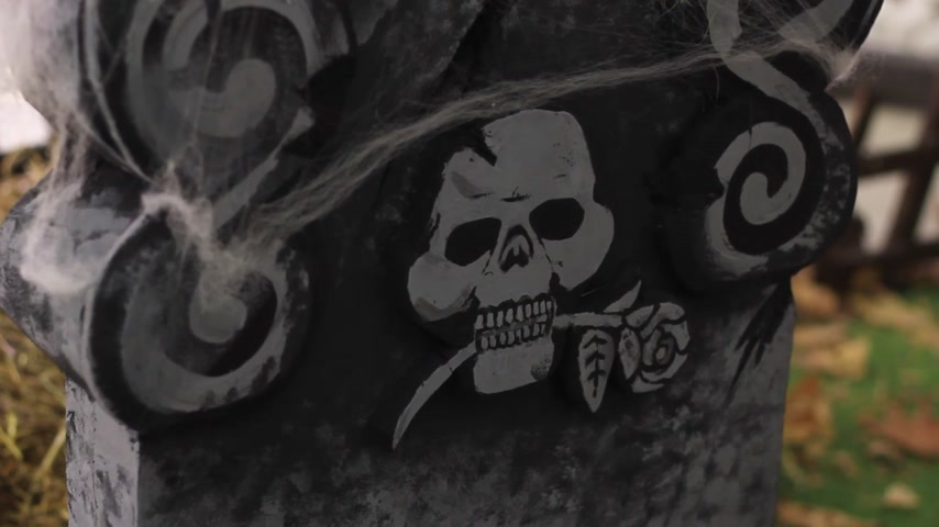 headstone : grave cross with a painted skull Stock Footage