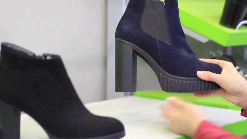 high heel shoe : Shopping. Female hands choose shoes with heels in the store