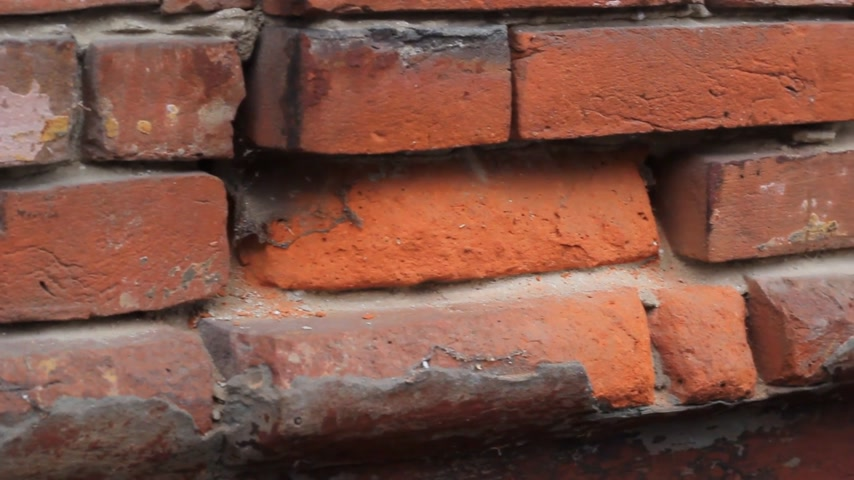 desigual : broken brick wall on the house Stock Footage