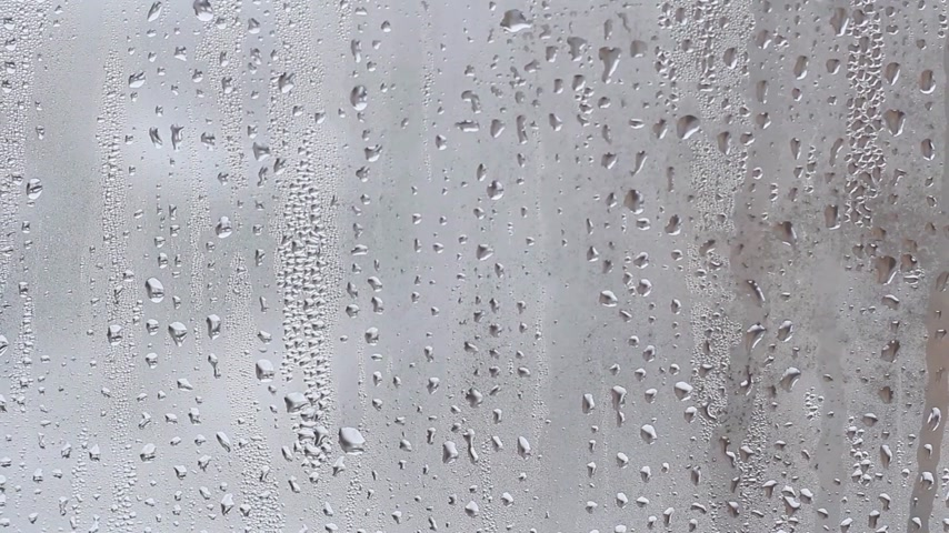 waterdrop : rain drops on the window with closed tulle Stock Footage