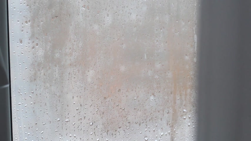 rain drops on the window with closed tulle Stock Footage