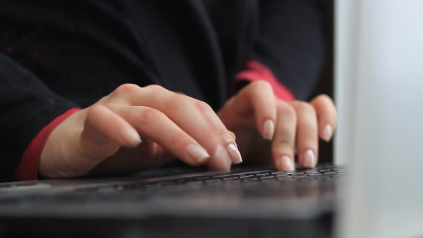 Womens hands work with a laptop Stock Footage