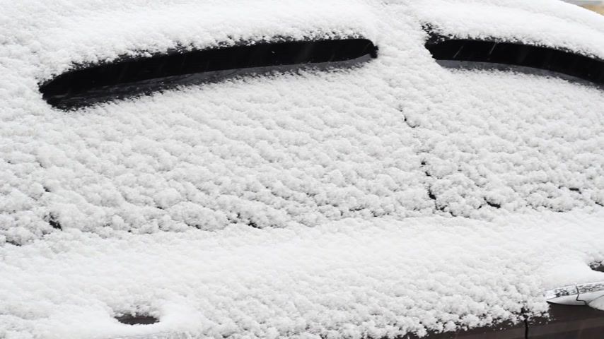 side windows of a car in the snow close up Stock Footage
