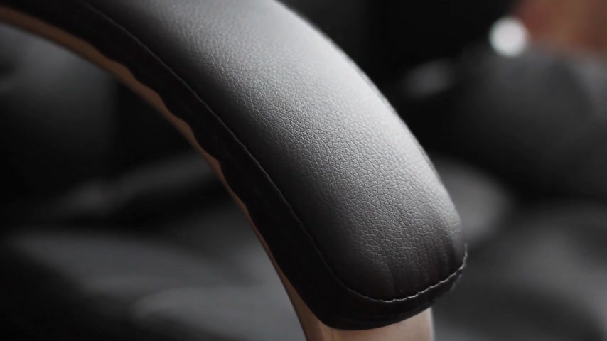 leather office chair handle close up