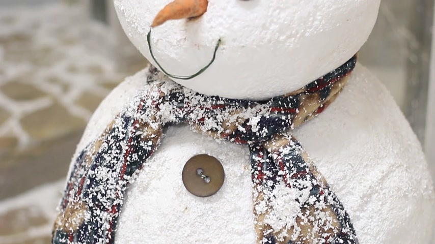 snow caps : Artificial snowman in a photo studio close up Stock Footage