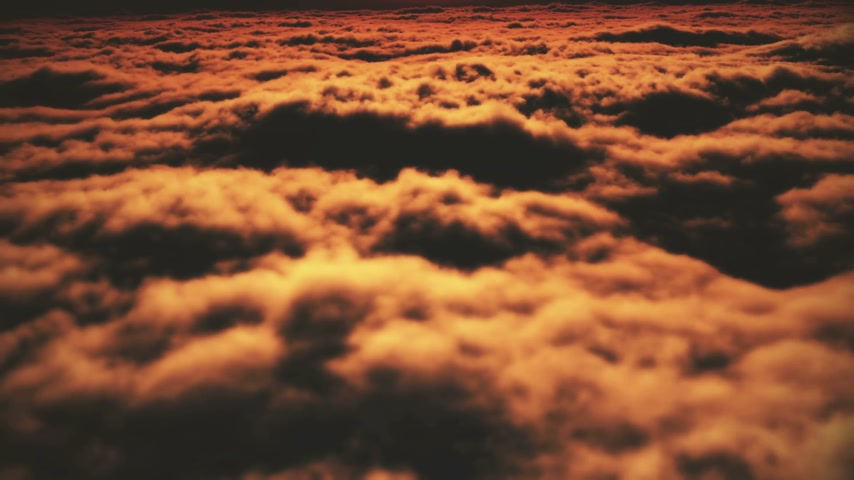 fluffy cloudy : sunset above clouds Stock Footage