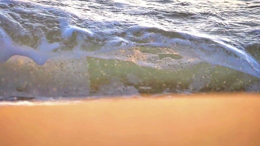 seixos : beach wave macro sunset slow motion