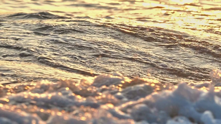 glowing sunlight on water : beach wave macro sunset slow motion