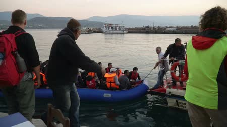 lifesavers : LESVOS, GREECE - NOV 5, 2015: Refugees who were rescued in the sea. Towing to the coast.