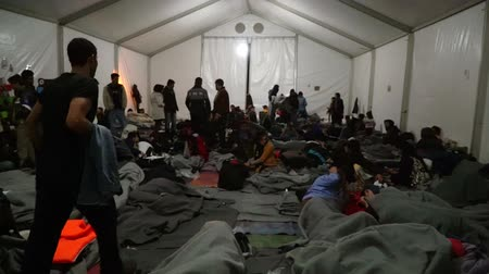 lifesavers : LESVOS, GREECE - NOV 5, 2015: Refugees inside a tent at the camp in the evening.