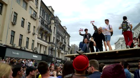 climbed : RUSSIA, MOSCOW - JUNE 12, 2017: Rally Against Corruption Organized by Navalny on Tverskaya Street. People climbed onto the roof above the crowd.