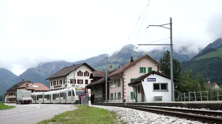 Albeuve, Switzerland - SEP 6, 2017: The train arrives at Albeuve station. It is a small town in the Gruyeres district, Canton of Friborg, Switzerland. Wideo