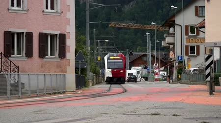 Montbovon, Switzerland - SEP 6, 2017: the train passes right through the street of a small town Montbovon in the Gruyer district, Canton of Friborg, Switzerland. Wideo