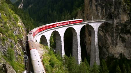 The train passes through the famous Landwasser viaduct in Switzerland. Top view. Wideo