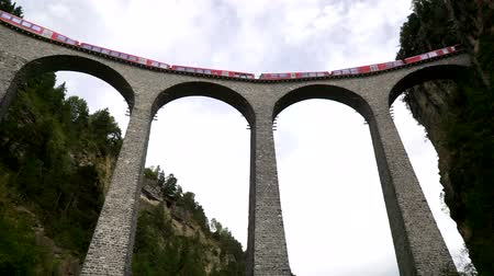 The train passes through the famous Landwasser viaduct in Switzerland. Bottom view. Wideo