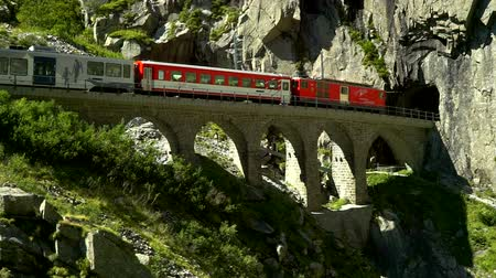The train passes through the viaduct. Place near the Devils bridge. Andermatt, Switzerland.