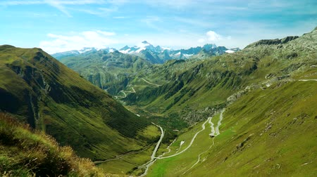 Panoramic view of the mountains from the Furka pass in the Swiss Alps. Movement of the camera using a Steadicam.