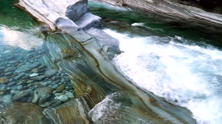 The valley of the Verzasca river with clear water. Lavertezzo, Switzerland. Wideo