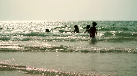 nadador : Arab children happily bathe the sea on a wild beach. UAE Stock Footage