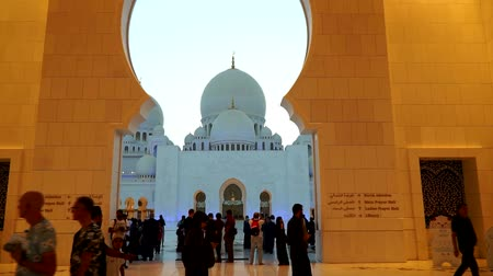 ABU DHABI, UAE - APRIL 2018: The Sheikh Zayed Grand Mosque in the evening. Smooth movement through the Central entrance to the courtyard.