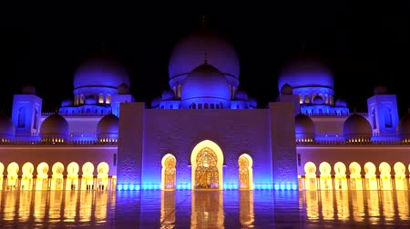 ABU DHABI, UAE - APRIL 2018: Sheikh Zayed Grand Mosque later in the evening. Timelapse.