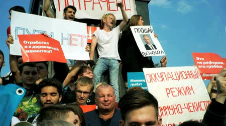 RUSSIA, MOSCOW - AUGUST 09, 2018: Rally Against Pension Reform. The crowd shouts: DOWN WITH THE KING