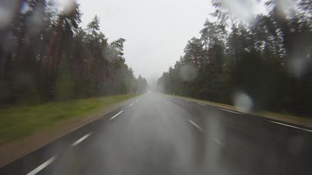 side view : driving in the rain, rear view
