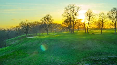 pans : Sunset in the spring park, panoramic time-lapse Stock Footage
