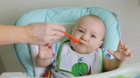 gruel : Mother Feeding Little Baby Stock Footage
