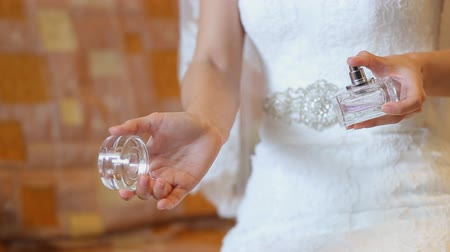 eau : bride applying perfume on her wrist Stock Footage