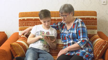 grandchild : Grandmother and Grandson Using Tablet