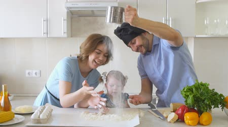 ebéd : Happy Family is Cooking in The Kitchen. Dad Sifts Flour Slow motion.