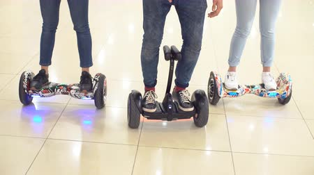 gyro : Young hipsters move around the shopping center on a hyroscooter Stock Footage