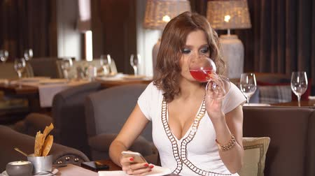 клуб : Young girl drinking red wine in restaurant