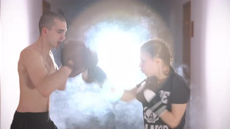 eğitici : Trainer with apprentice conduct sparring. Stok Video