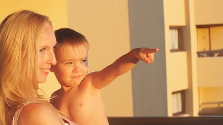 сумерки : Happy mother and son having fun on sunset. Slow motion Стоковые видеозаписи
