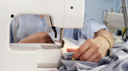 fashion business : Sewing Machine and Dressmaker in Working Process. Sewing Business. Needlework Stock Footage