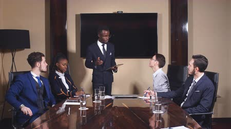 Black Leader of Business People Giving a Speech in a Conference Room.
