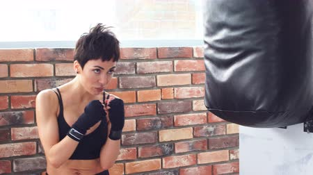 Young female boxer training fitness boxing at gym, exercise fitness for healthy and slim body.
