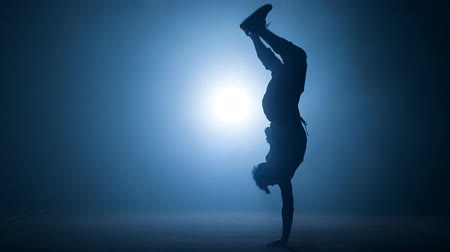 breakdancing : Young stuntman performing the trick in the air. Stock Footage