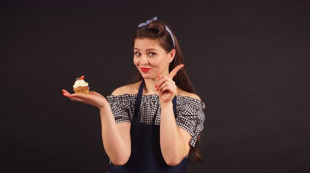 baker : Emotional girl pastry shows the hand gestures, the concept of healthy eating.