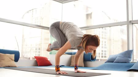 アーサナ : Sporty young woman doing yoga practice - concept of healthy life and natural balance between body and mental development. 動画素材