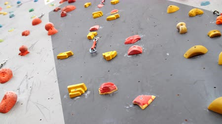 bouldering : Indoor Climbing gym wall detail close up.