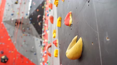 bouldering : Climbing gym. Colorful footholds for training.