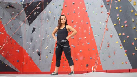 bouldering : Portrait of attractive young climber having training in gym.