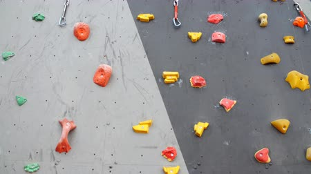 bouldering : Artificial climbing wall. Climbing wall for practicing. Rock climbing wall. Stock Footage