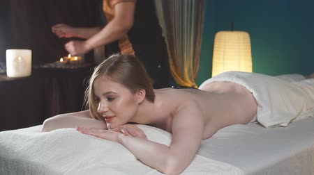 閉じた : Woman enjoing back massage at spa. Leisure, Health, Luxury Lifestyle Concept